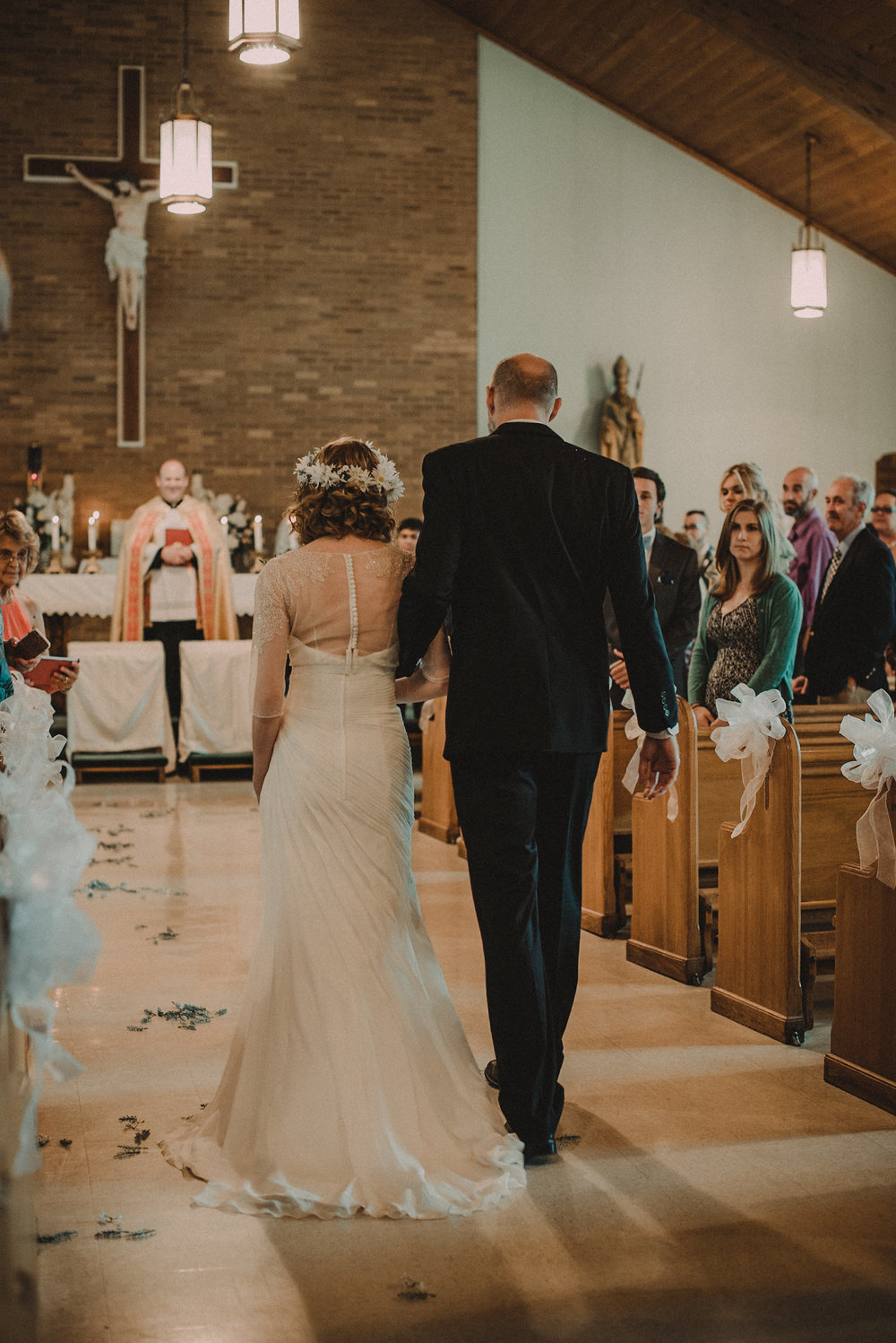 Bride walking down aisle in church