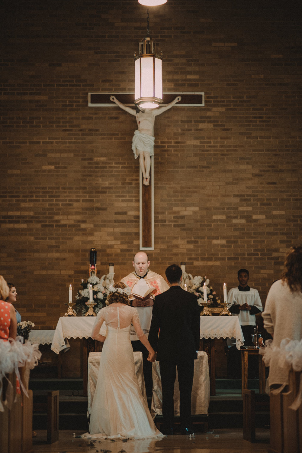 Bride and groom at altar during wedding