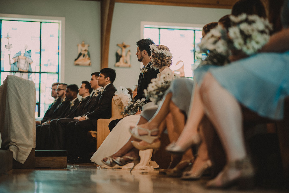 Bride and groom sitting during ceremony