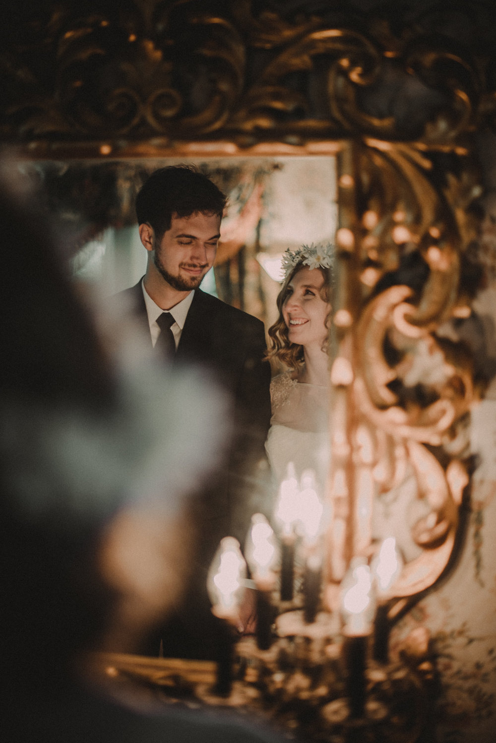 Bride and groom looking in mirror