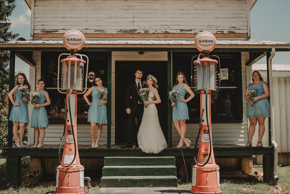Groom and bridesmaids on porch