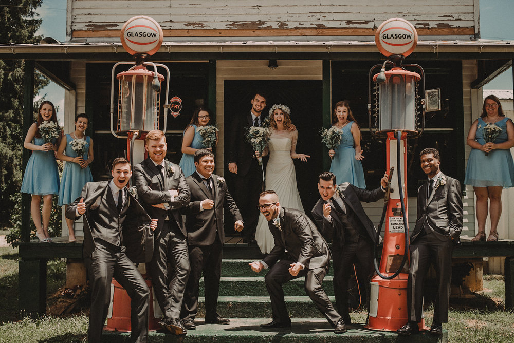 Bridal party at vintage gas station