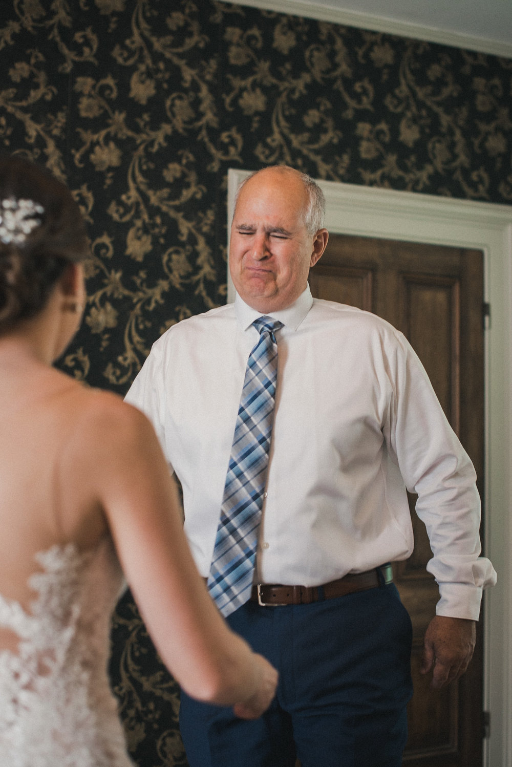 Father crying when seeing bride