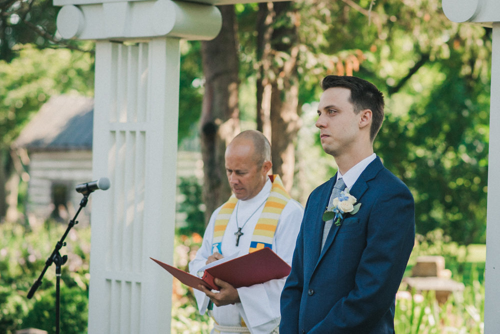 Groom waiting at altar