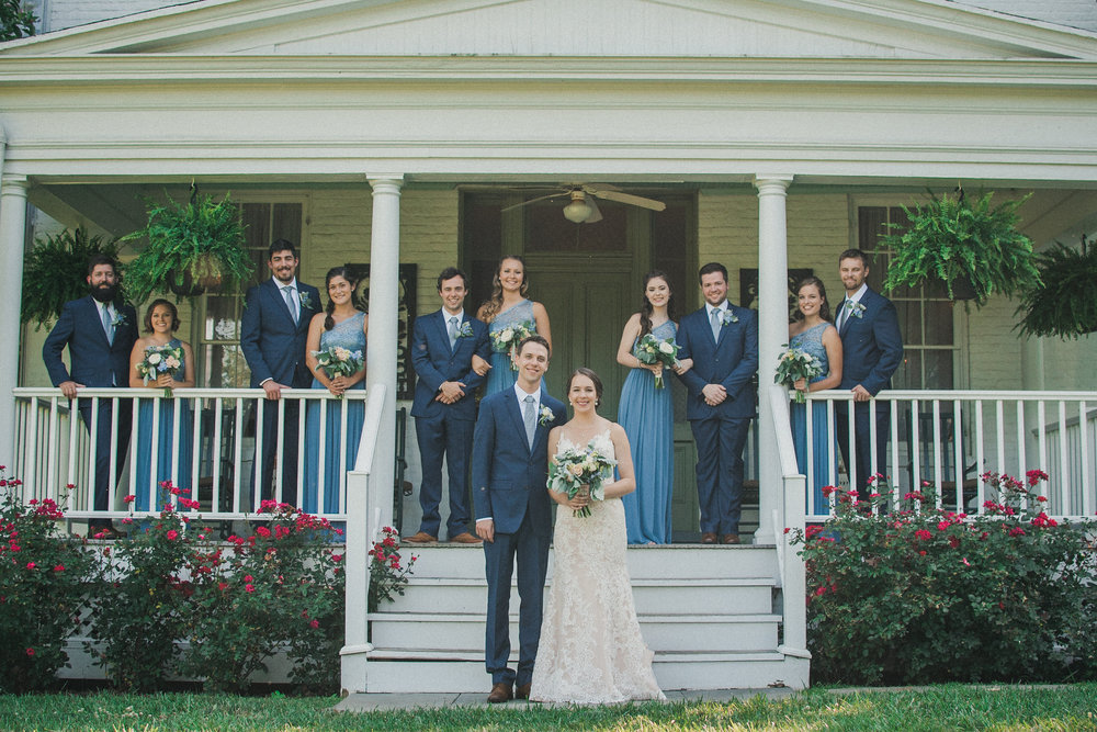 Bride and groom with bridal party on porch