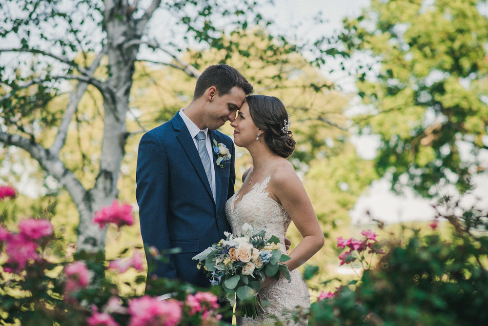 Bride and groom with roses