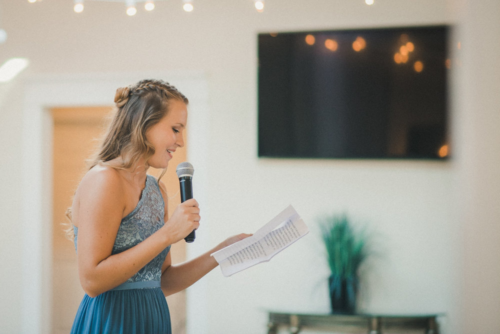 Bridesmaid giving speech at wedding