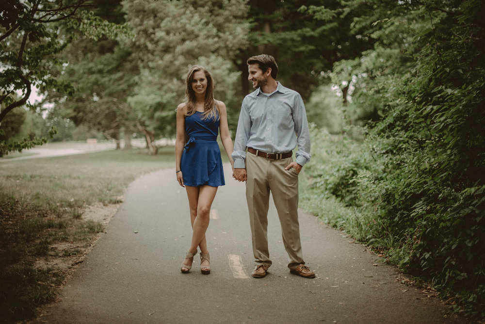 Man and woman standing in road