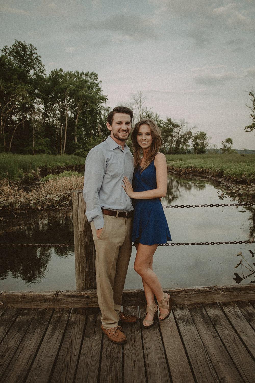 Couple posing on wooden bridge
