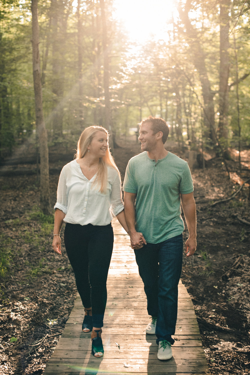 Man and woman walking through forest
