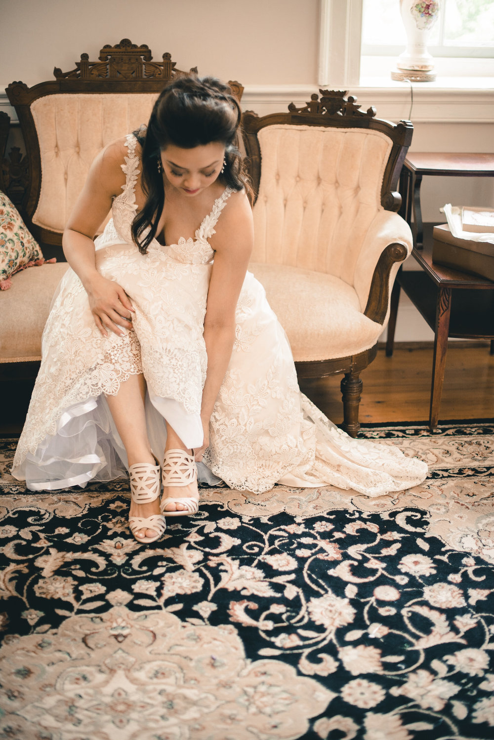 Bride putting on shoes