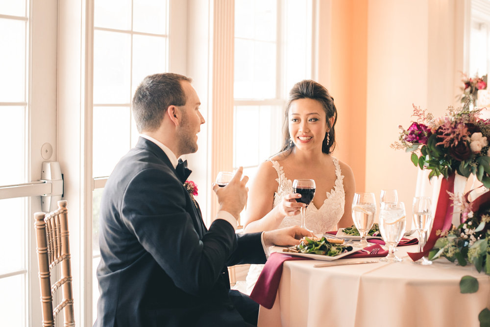 Bride and groom drinking wine