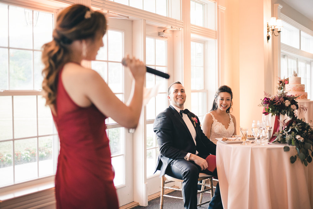 Bridesmaid toasting bride and groom