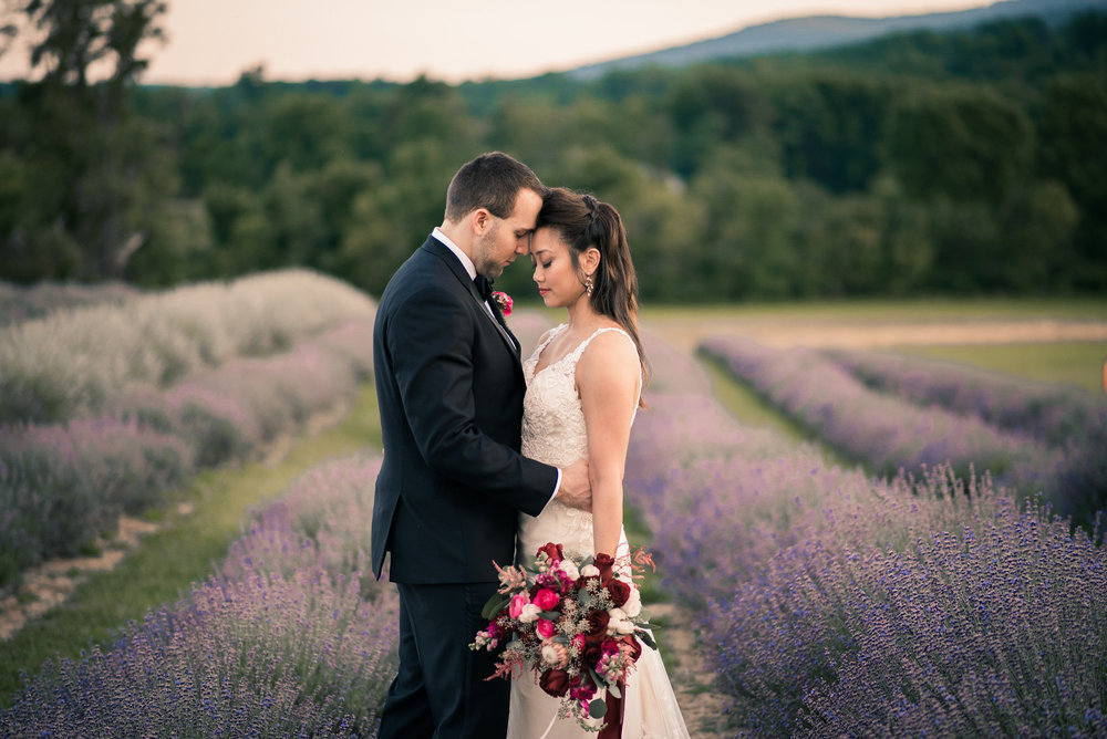 Bride and groom in lavendar field