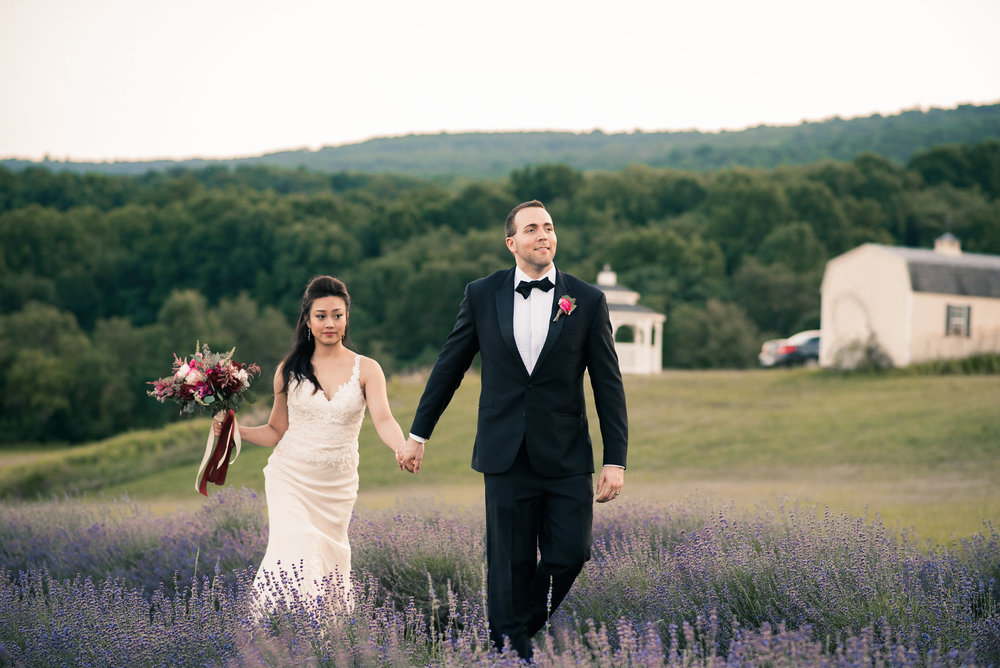 Groom and bride walking through lavender