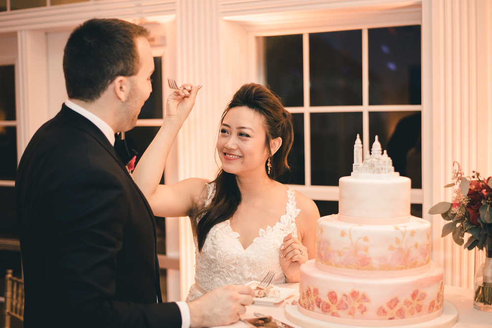 Bride feeding cake to the groom