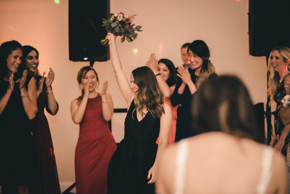 Wedding guest catching bouquet