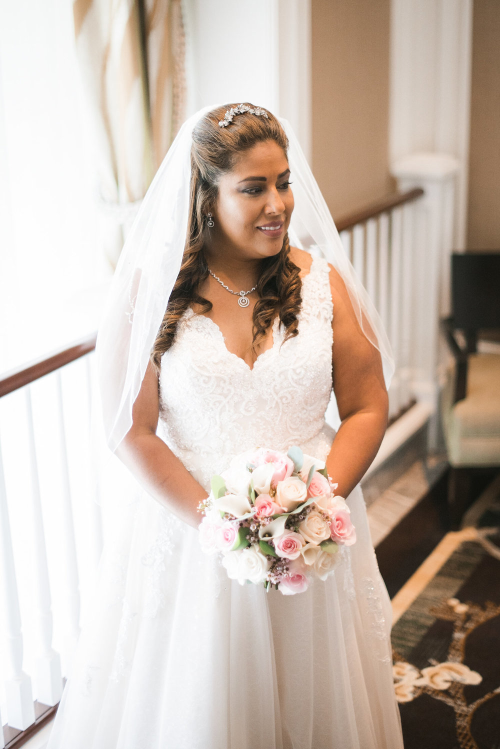 Bride standing on stair landing