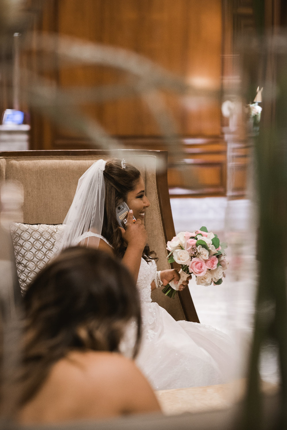 Bride talking on cell phone