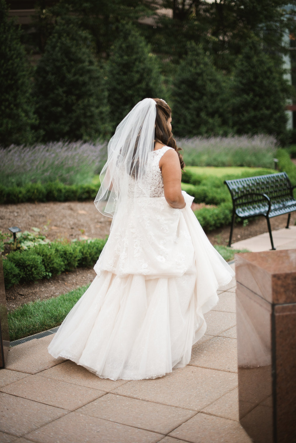 Bride walking through courtyard