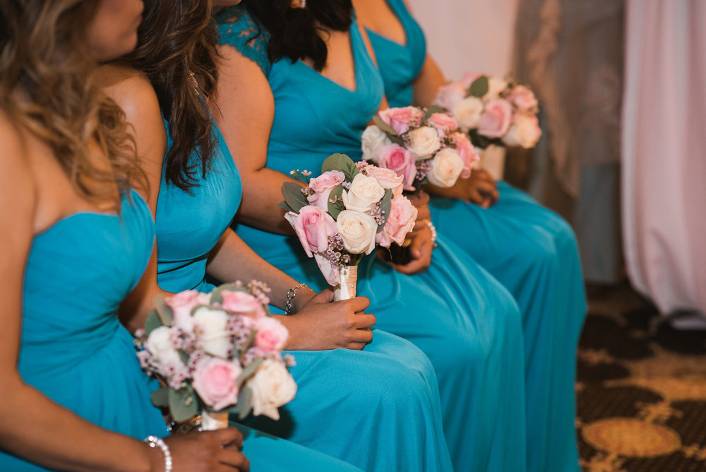 Bridesmaids sitting during wedding