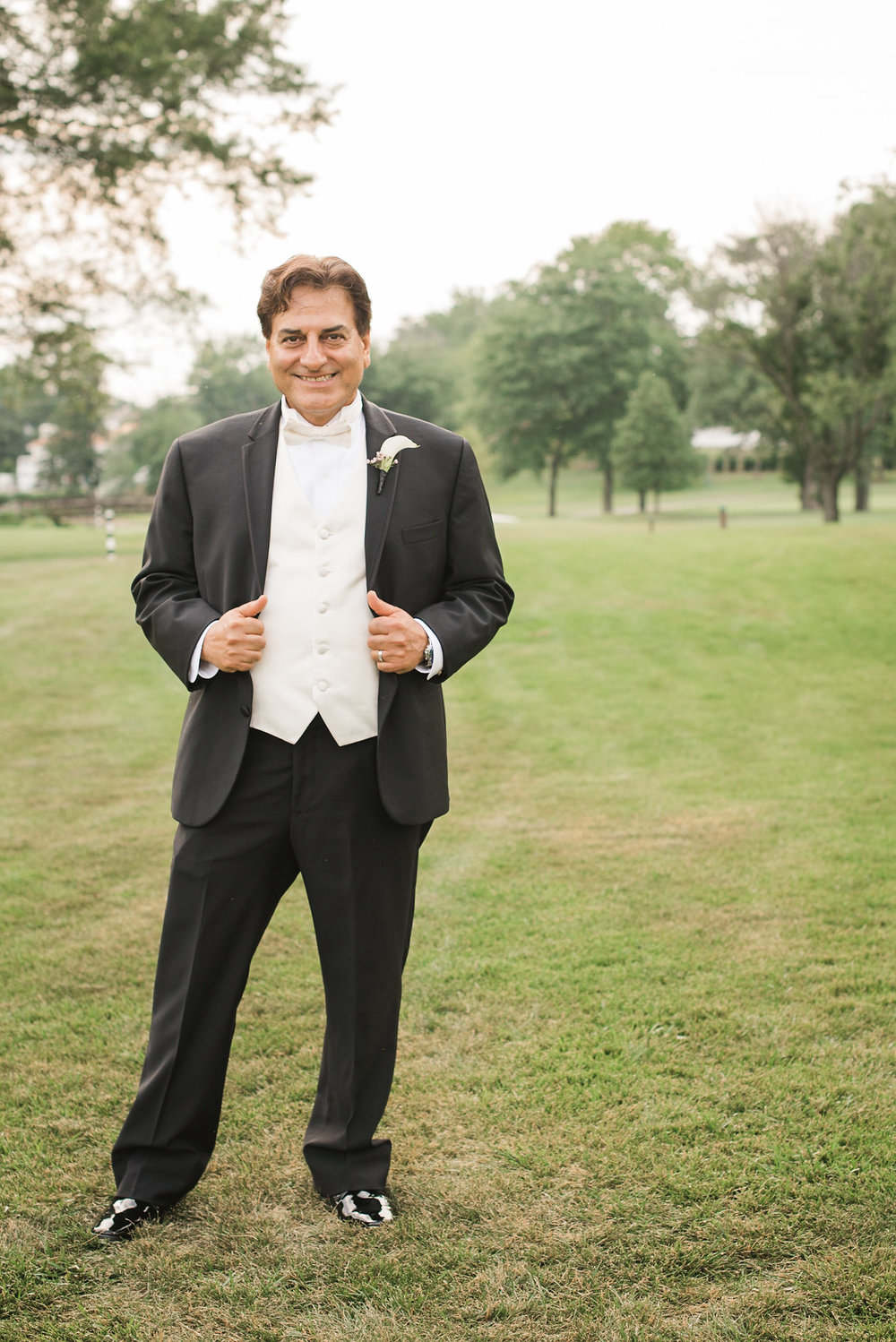 Groom standing on lawn