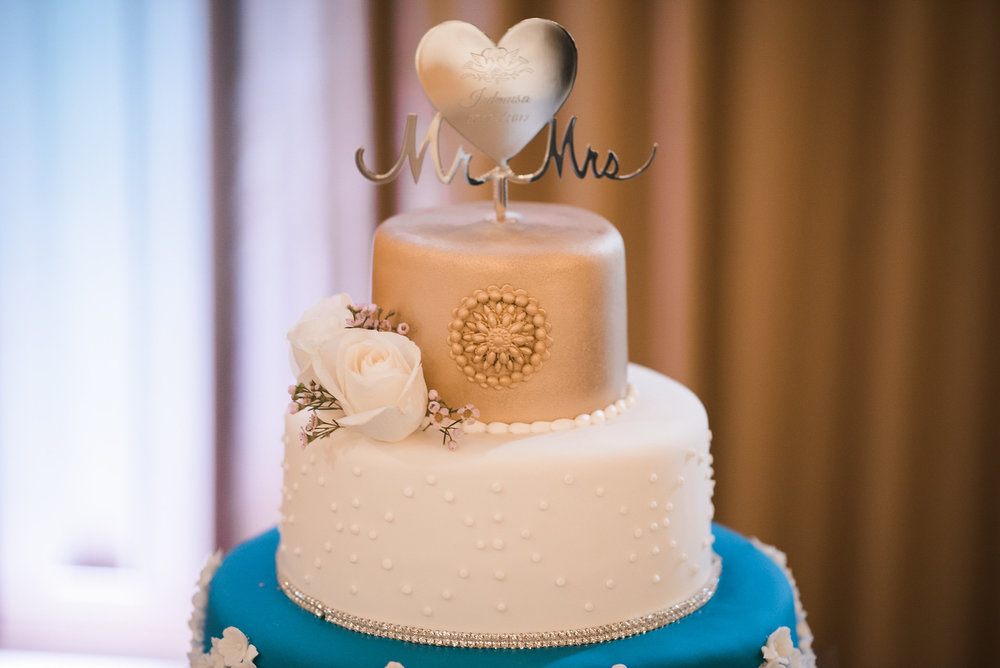 Gold wedding cake topper