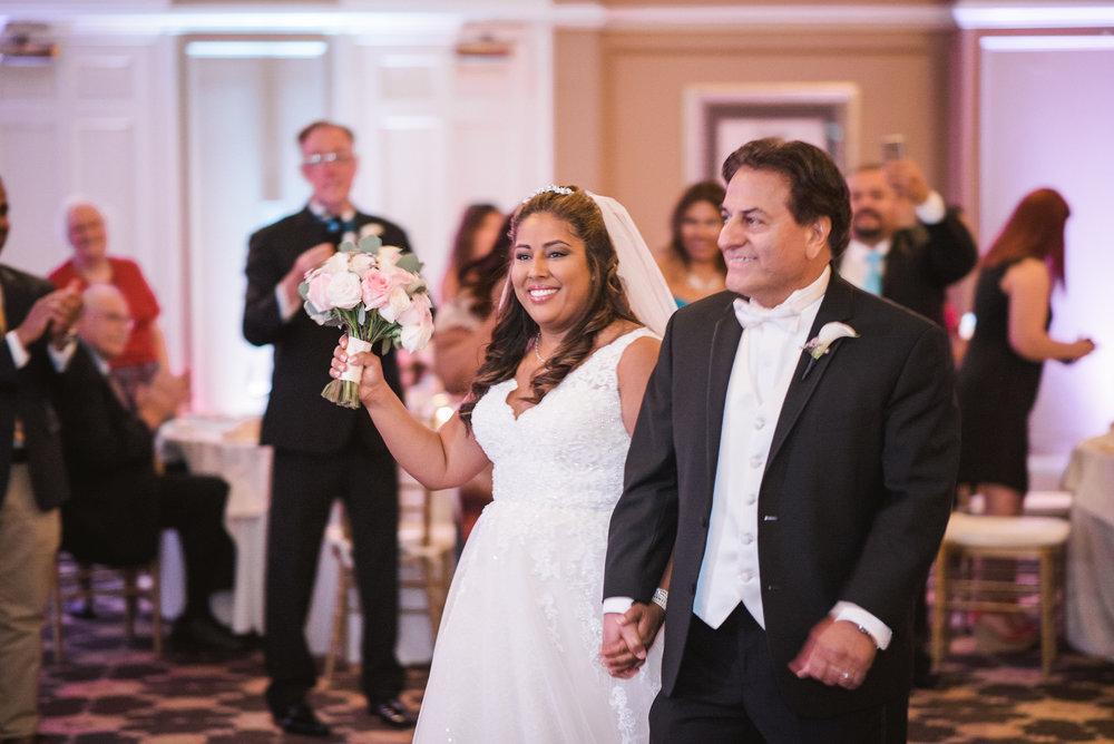 Bride and groom walking into reception