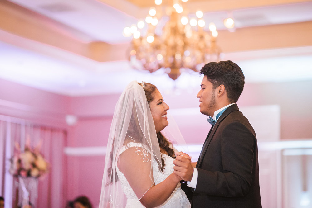 Bride dancing with groomsman