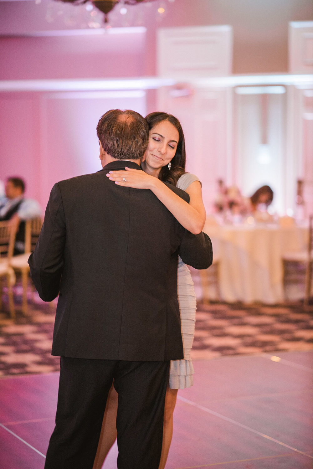 Groom dancing with daughter