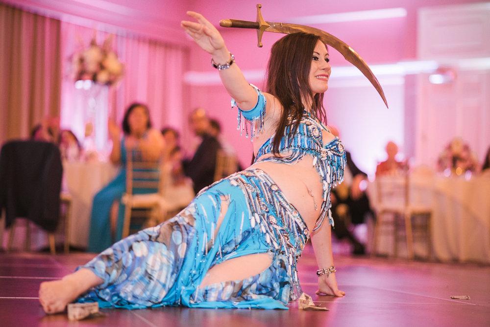 Belly dancer balancing sword