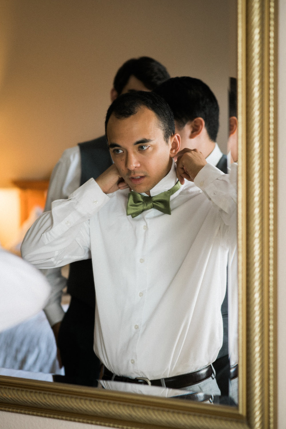 Groom ties bowtie