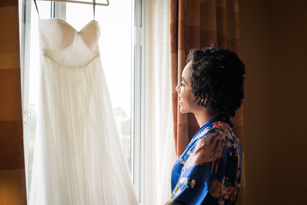 Bride looking at wedding dress