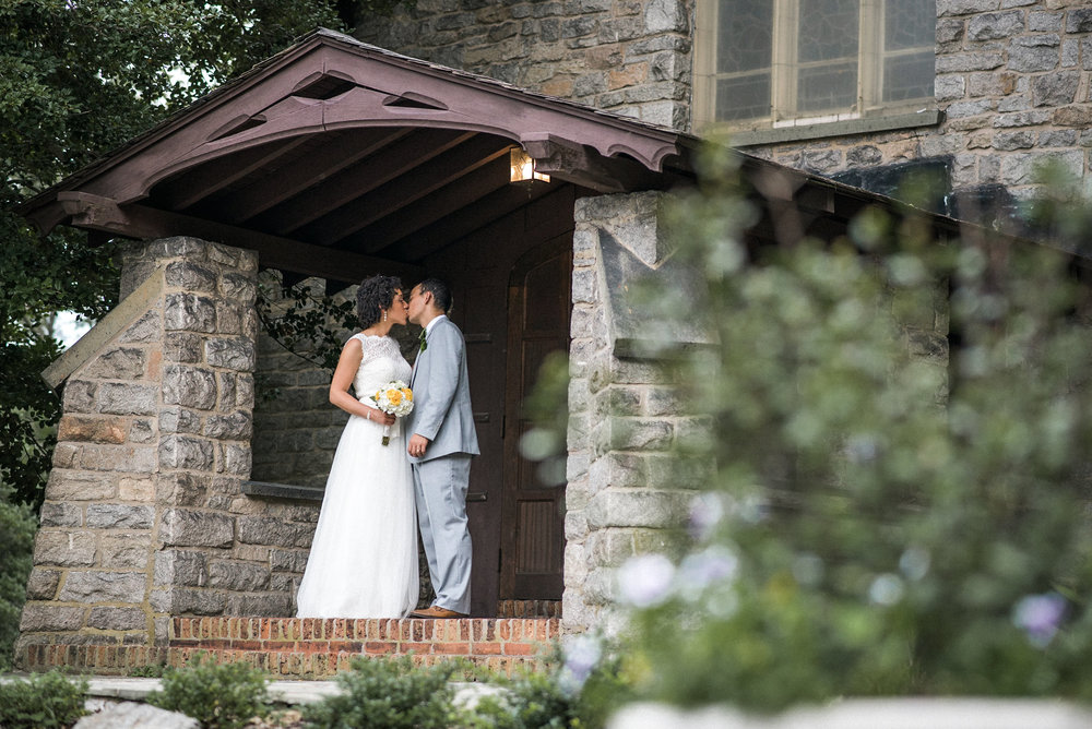 Bride and groom on church porch