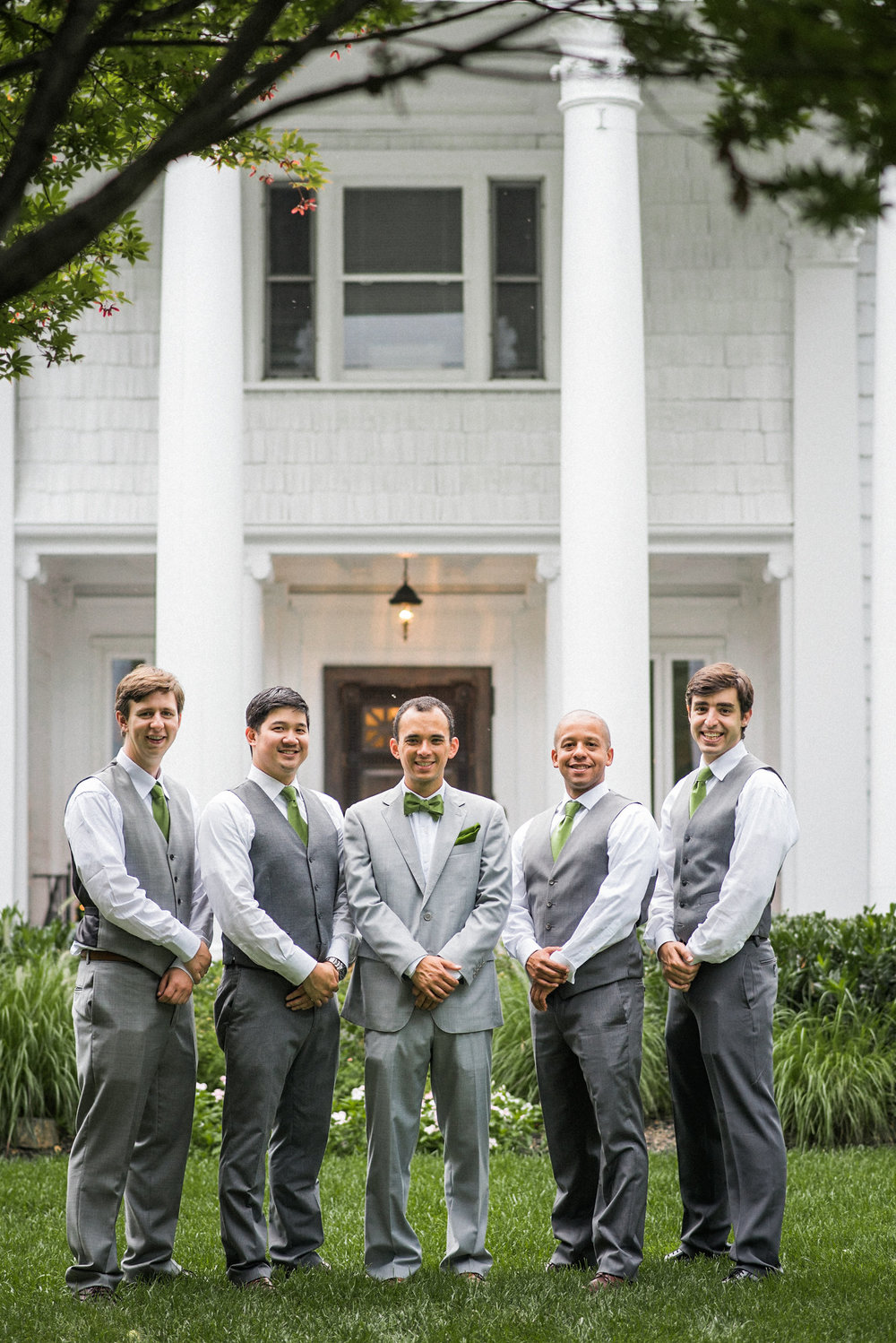 Groomsmen in front of columned porch