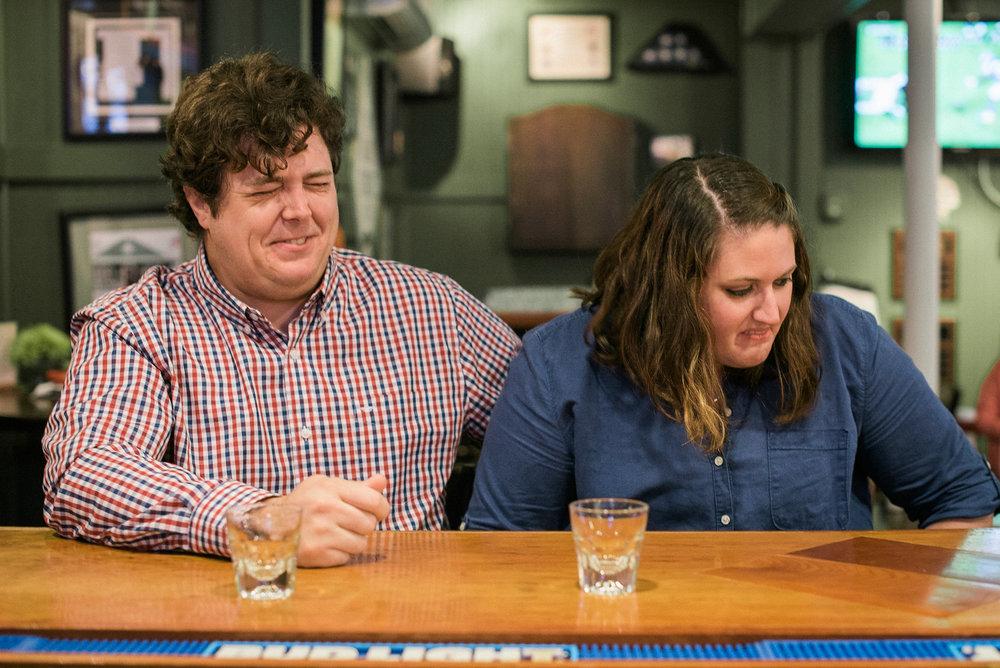 Grimacing couple at bar