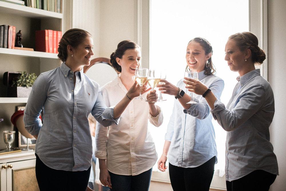Bride and bridesmaids having wine
