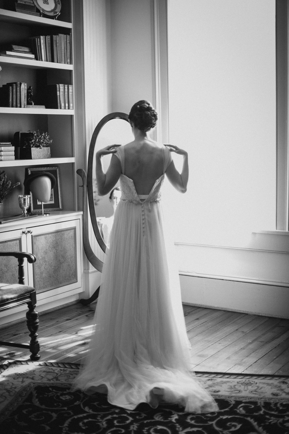Bride getting dressed in black and white