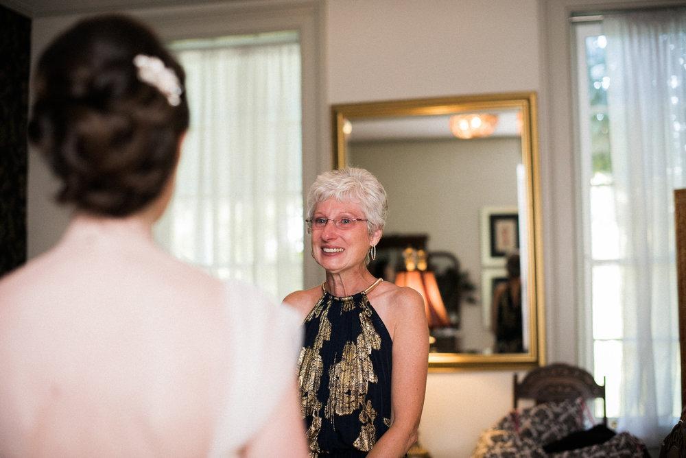 Bride's mother looking at bride