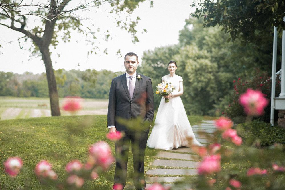 Bride standing behind groom