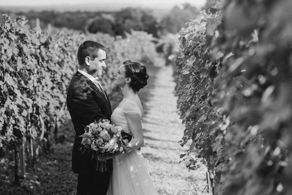 Bride and groom in vineyard in black and white