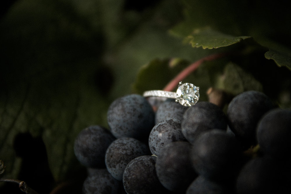 Engagement ring on bunch of grapes