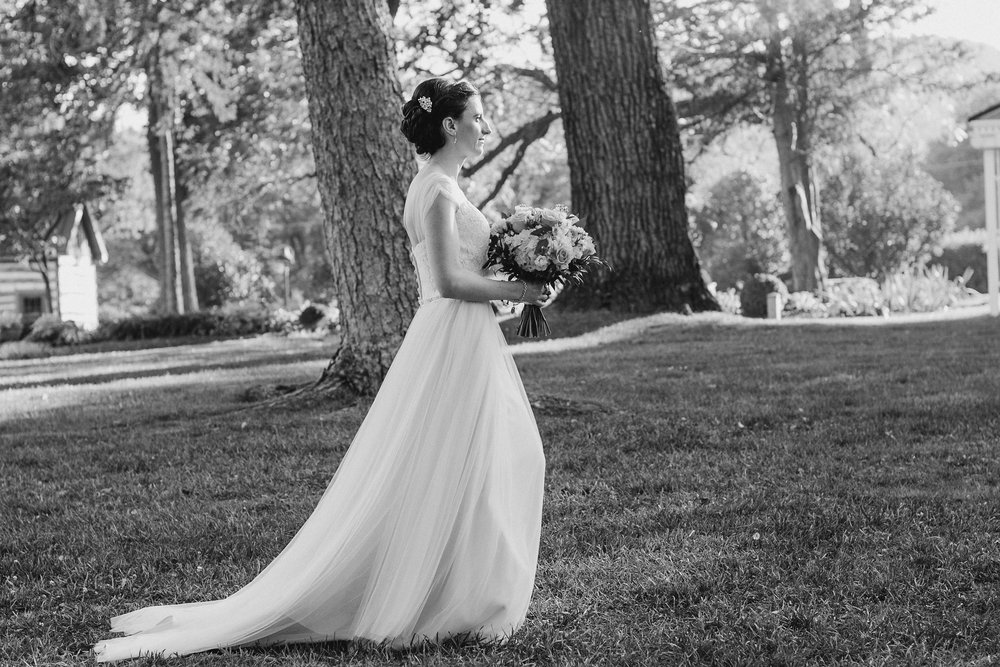 Bride walking down aisle in black and white