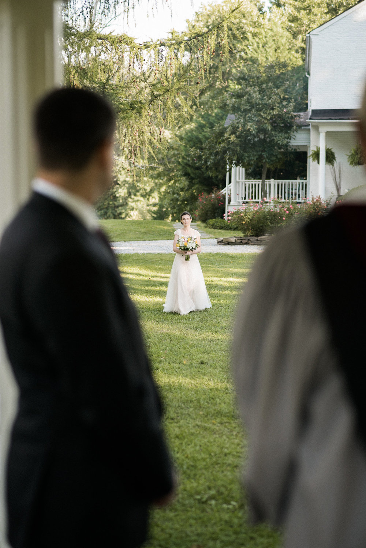 Bride walking down aisle toward groom