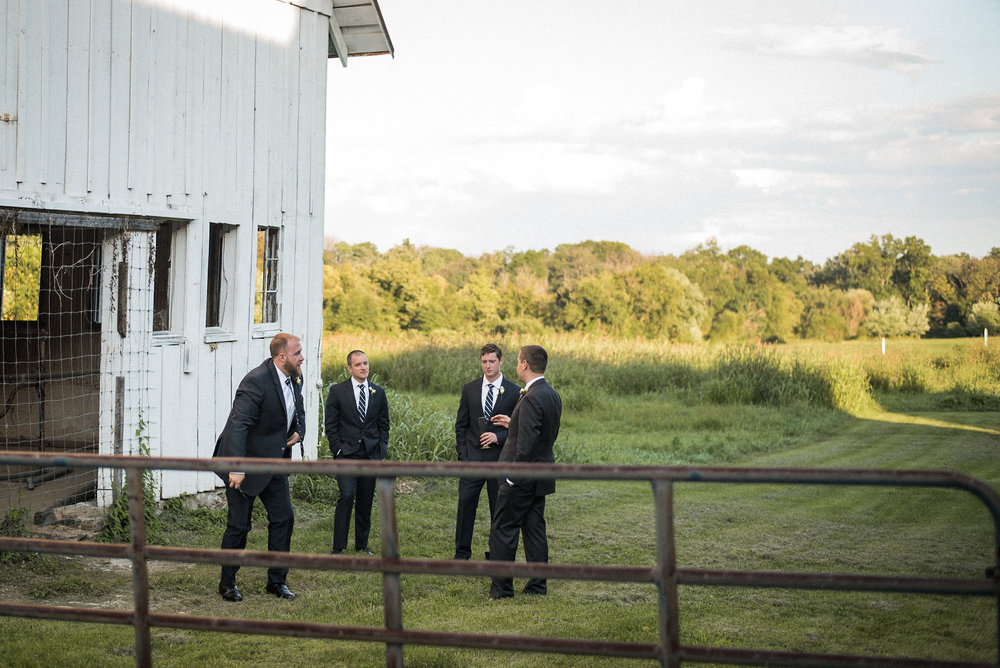 Groomsmen standing in field