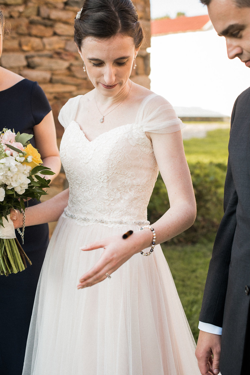 Bride with caterpillar on arm