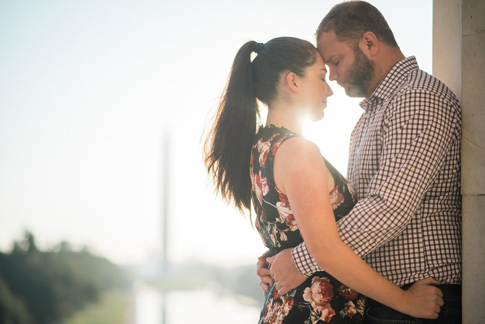 Man and woman hugging at sunset