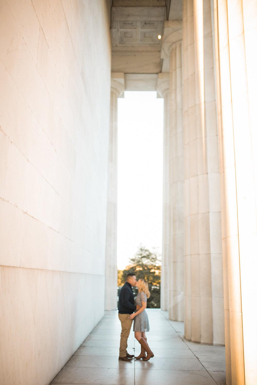 Couple hugging near columns