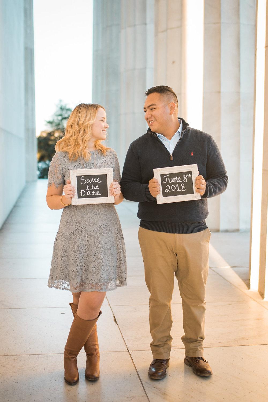 Engaged couple holding chalkboards