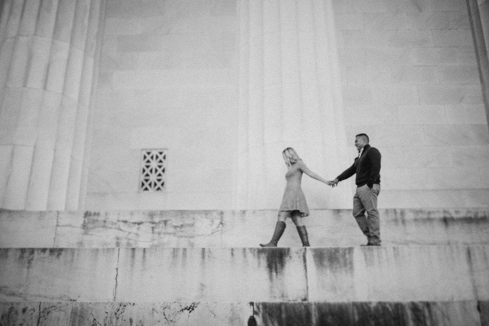 Woman leading man across steps